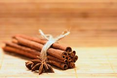Cinnamon and star anise on a wooden background. Beautiful and fragrant spices for Christmas time and winter cooking season. Stock Photos