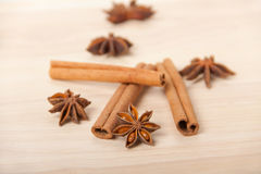 Cinnamon and star anise on wooden background Stock Photography