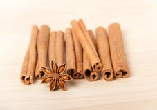 Cinnamon and star anise on wooden background Royalty Free Stock Photo