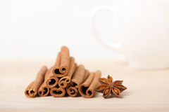 Cinnamon and star anise on wooden background Stock Images