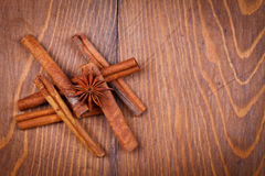 Cinnamon and star anise on wooden background Royalty Free Stock Photography