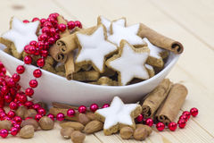 cinnamon star cookies, nuts and cinnamon stick Stock Images
