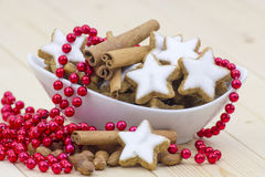 Cinnamon star cookies, nuts and cinnamon stick Royalty Free Stock Images