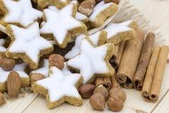 Cinnamon star cookies, nuts and cinnamon stick Royalty Free Stock Photos