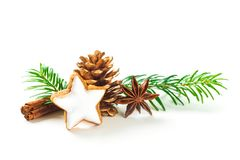 Cinnamon star shaped cookies with frosting,anis and fir cone isolated on white background. Cinnamon star shaped cookies with frosting,anis and fir coneisolated royalty free stock photo