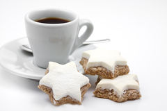 Cinnamon stars christmas cookies with cup Stock Photography