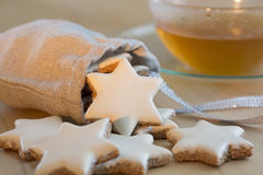 Cinnamon stars christmas cookies and tea cup Stock Photography