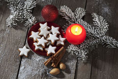 Cinnamon stars with Christmas decoration on wooden background Stock Photo