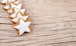 Cinnamon stars for christmas on wood Stock Photography