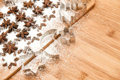 Cinnamon stars and cookies cutters. christmas sweet food Stock Photography