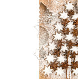 Cinnamon stars and cookies cutters over white. christmas food Stock Photos