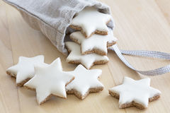 Cinnamon stars falling out a small bag Stock Photo