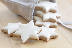 Cinnamon stars falling out a small bag Royalty Free Stock Images
