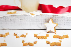 Cinnamon stars in front of white wood Stock Image