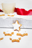 Cinnamon stars in front of a white wooden tray Royalty Free Stock Image