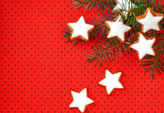Cinnamon stars on red background Royalty Free Stock Photo