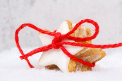 Cinnamon stars with ribbon Royalty Free Stock Images