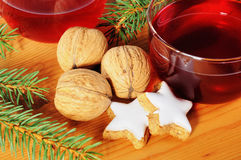 Cinnamon stars and walnuts with Tea cup Royalty Free Stock Image