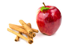 Cinnamon stick with apple Royalty Free Stock Image