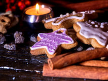 Cinnamon stick background with Christmas gingerbread man on wooden table Stock Photos