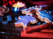 Cinnamon stick background with Christmas gingerbread man on wooden table Royalty Free Stock Photos