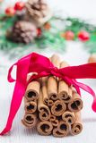Cinnamon stick with christmas decoration. Some cinnamon stick with christmas decoration Stock Images