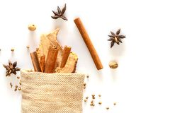 Cinnamon stick and dried ginger in sack with spices Stock Photo