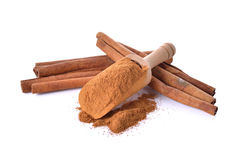 Cinnamon stick and powdered with spoon on white Royalty Free Stock Image