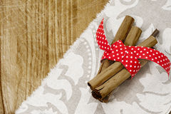 Cinnamon stick and red riboon Royalty Free Stock Image