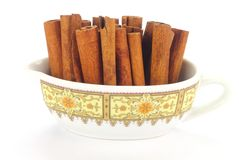 Cinnamon Stick. In a small Bowl on White Back Ground Royalty Free Stock Photography