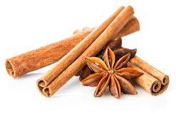 Cinnamon stick and star anise spice close-up isolated on white background. Stock Photo