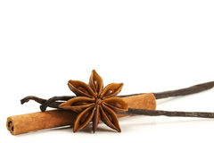 Cinnamon stick, star anise and two vanilla beans. On white background Royalty Free Stock Image
