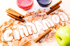Cinnamon stick at a white table Stock Photo