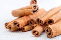 Cinnamon stick on white wooden background. Some cinnamon stick on white wooden background Royalty Free Stock Photo