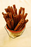 Cinnamon Sticks. A bunch of cinnamon sticks in a ceramic container Stock Photography