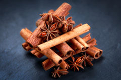 Cinnamon sticks and anice on blue stone background. selected focus. Cinnamon sticks and anice on wooden table. selected focus stock photos