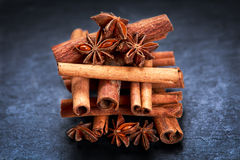 Cinnamon sticks and anice on blue stone background. selected focus. Cinnamon sticks and anice on wooden table. selected focus stock photography