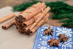 Cinnamon sticks and anice. Winter background Royalty Free Stock Photo