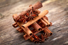 Cinnamon sticks and anice on wooden table. selected focus.  stock photo