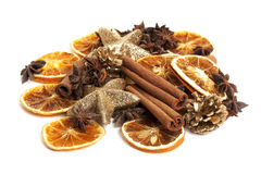 Cinnamon sticks, anis and dried oranges. Christmas decoration stock photos
