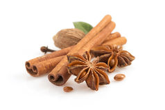 Cinnamon sticks, anise star and spices on white Stock Photo