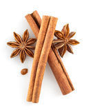 Cinnamon sticks and anise star on white Stock Photography