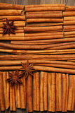 Cinnamon sticks and anise star on wooden background Royalty Free Stock Photo