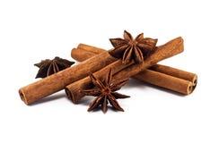 Cinnamon sticks and anise stars. On white background Stock Photo