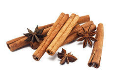 Cinnamon sticks and anise stars. On white background Royalty Free Stock Photos