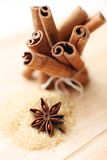 Cinnamon sticks and anise stars Stock Photos