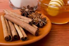 Cinnamon sticks and anise stars Royalty Free Stock Photos