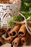 Cinnamon sticks and anise stars on christmas table. Stock Photography