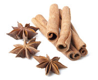 Cinnamon sticks and anise stars close-up on white. Background Royalty Free Stock Image