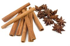 Cinnamon sticks and anise stars. Closeup isolated on a white background Royalty Free Stock Photography